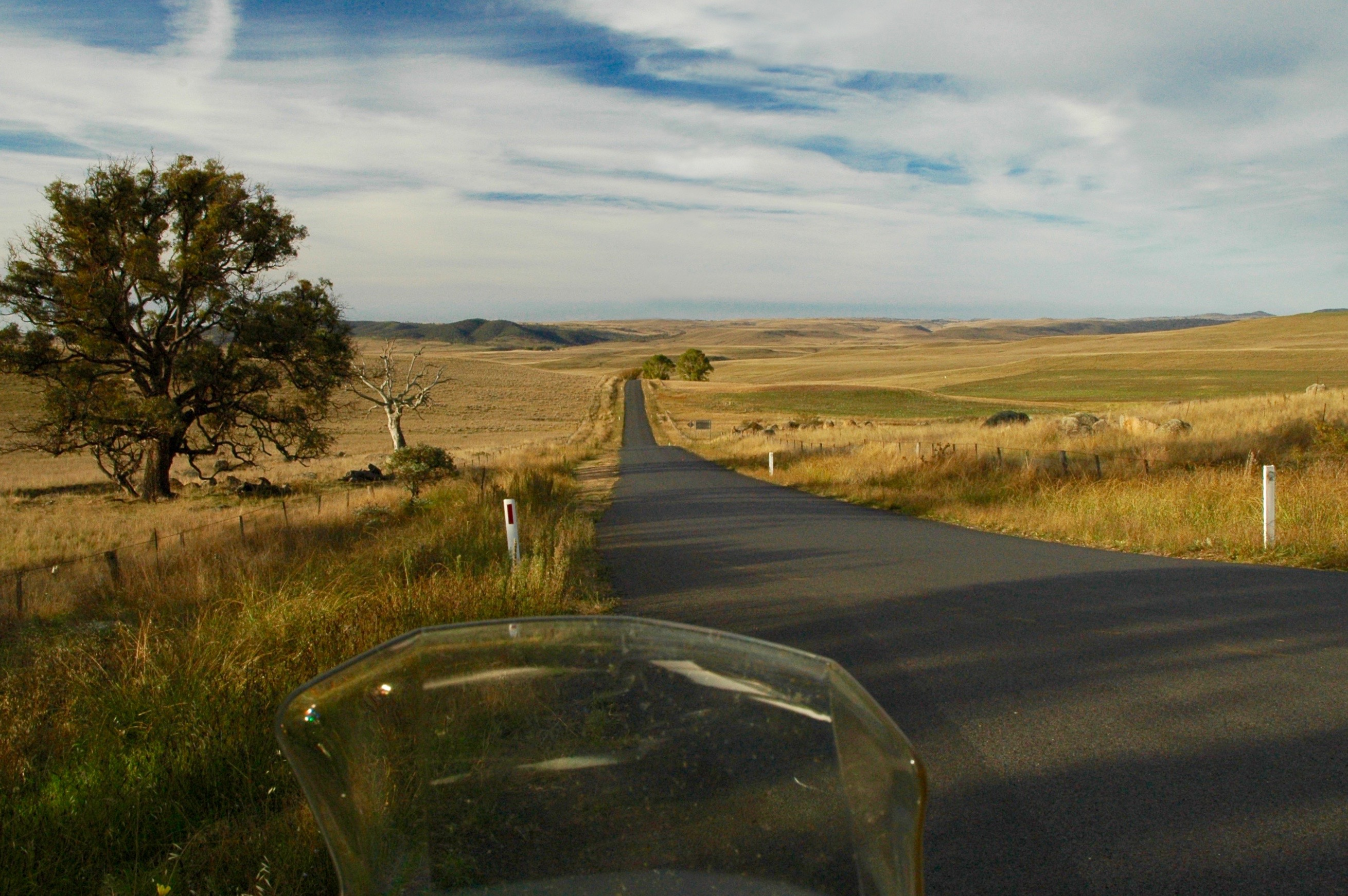 Photo of the open road from a motorbike