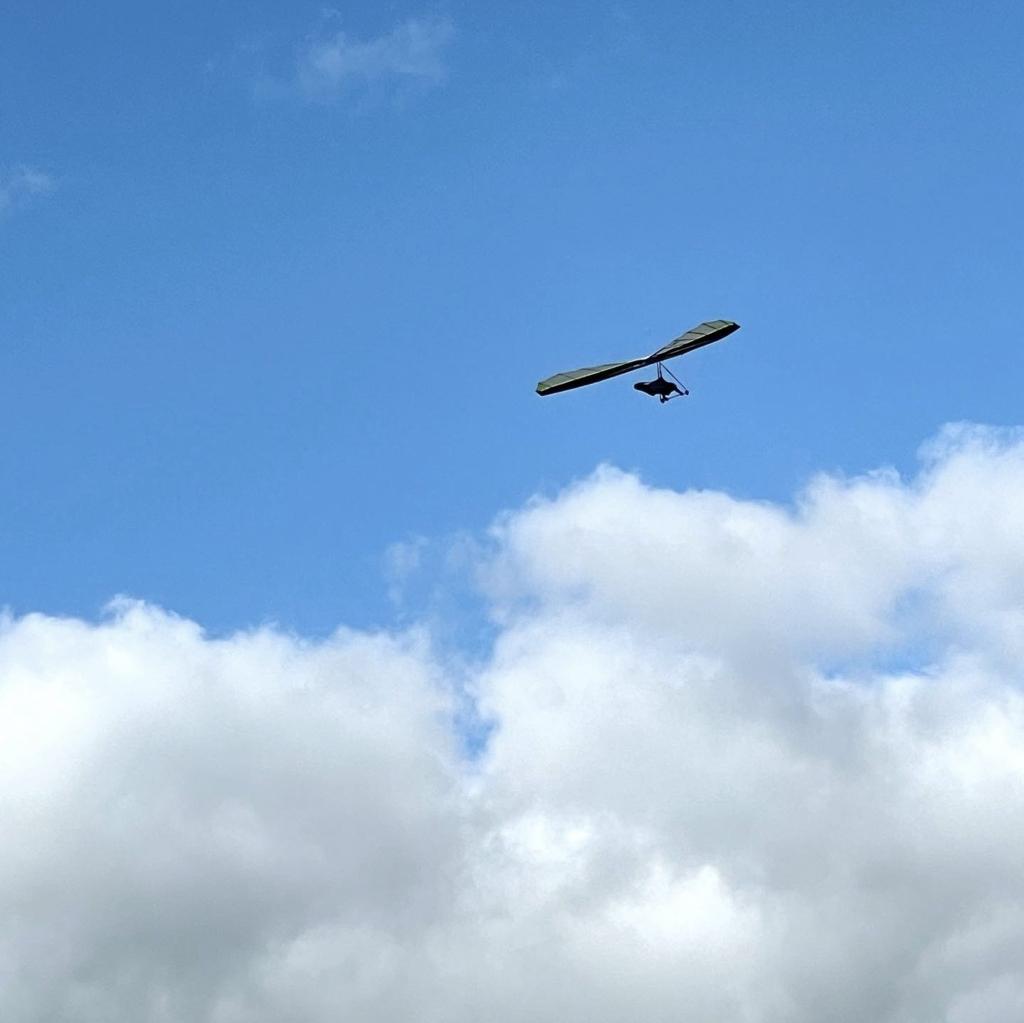 Airborne Fun 190 hang glider soaring near clouds